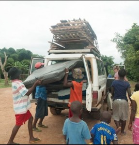 Staff & kids help to move the children's' beds to their new, temporary home.